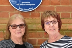 Jenny Spires (L) and Rosemary Breen (R) stand underneath Syd Barrett's Blue Plaque